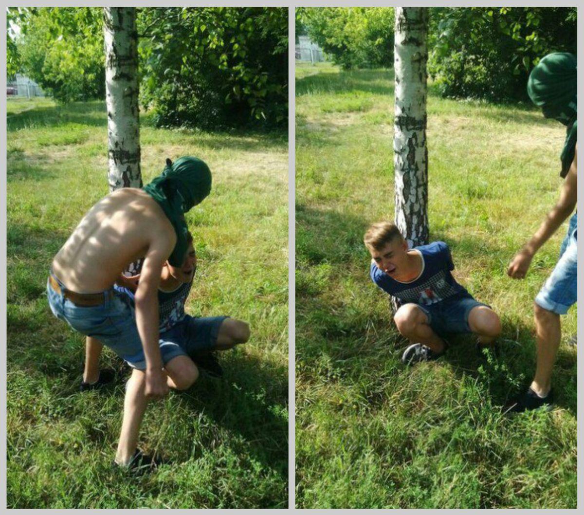 Девятиклассник Влад, который спустя какое-то время покончил жизнь самоубийством, привязан к дереву. Что происходит на фотографии и кто стоит рядом с ним, неизвестно. Автор фото неизвестен