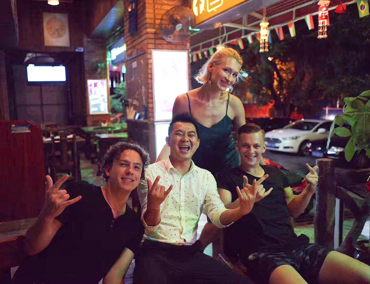 Артем Говса (крайний справа) вместе с директором группы Honey band и коллегами по работе. Фото: архив Артема Говсы