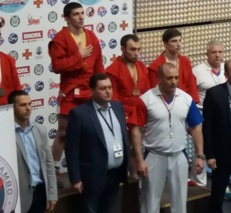 Александр Панасеня (второй слева) на пьедестале. Фото: Евгений ВАСИЛЕВСКИЙ